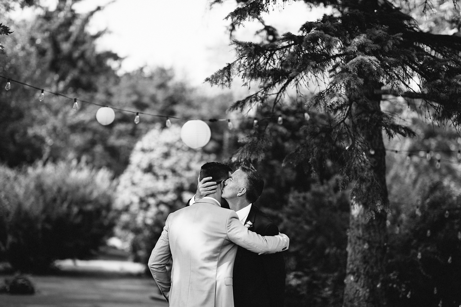 Backyard-family-intimate-cottage-wedding-chatum-kent-toronto-ontario-film-photographer-ryanne-hollies-photography-diy-documentary-photojournalistic-candid-moments-groom-and-dad-hugging.jpg
