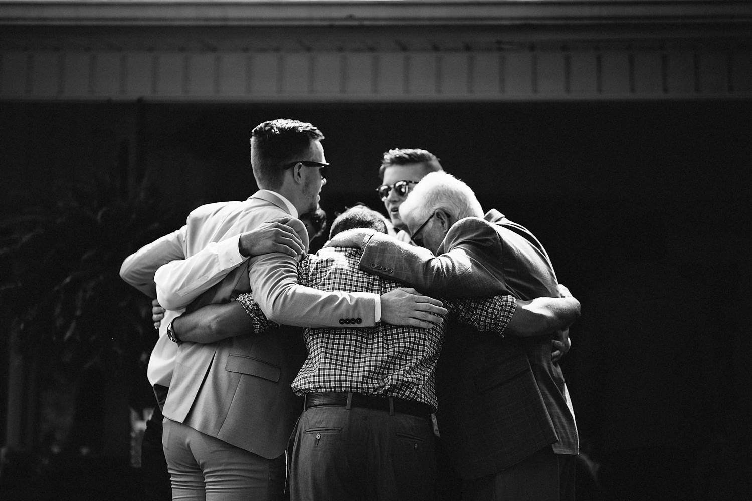 Backyard-family-intimate-cottage-wedding-chatum-kent-toronto-ontario-film-photographer-ryanne-hollies-photography-diy-documentary-photojournalistic-candid-moments-boys-hugging-bw.jpg