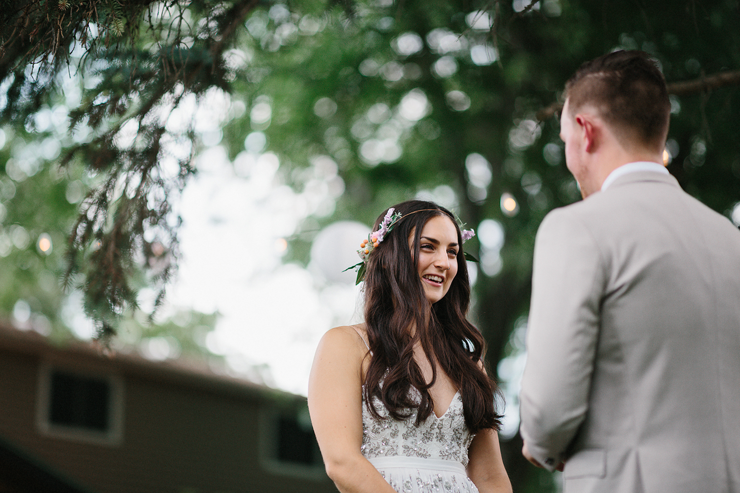 Backyard-family-intimate-cottage-wedding-chatum-kent-toronto-ontario-film-photographer-ryanne-hollies-photography-diy-string-lights-ceremony-space-lanterns-groom-and-bride-ring-exchange-emotional-vintage-bridal-style-with-flower-crown-.jpg