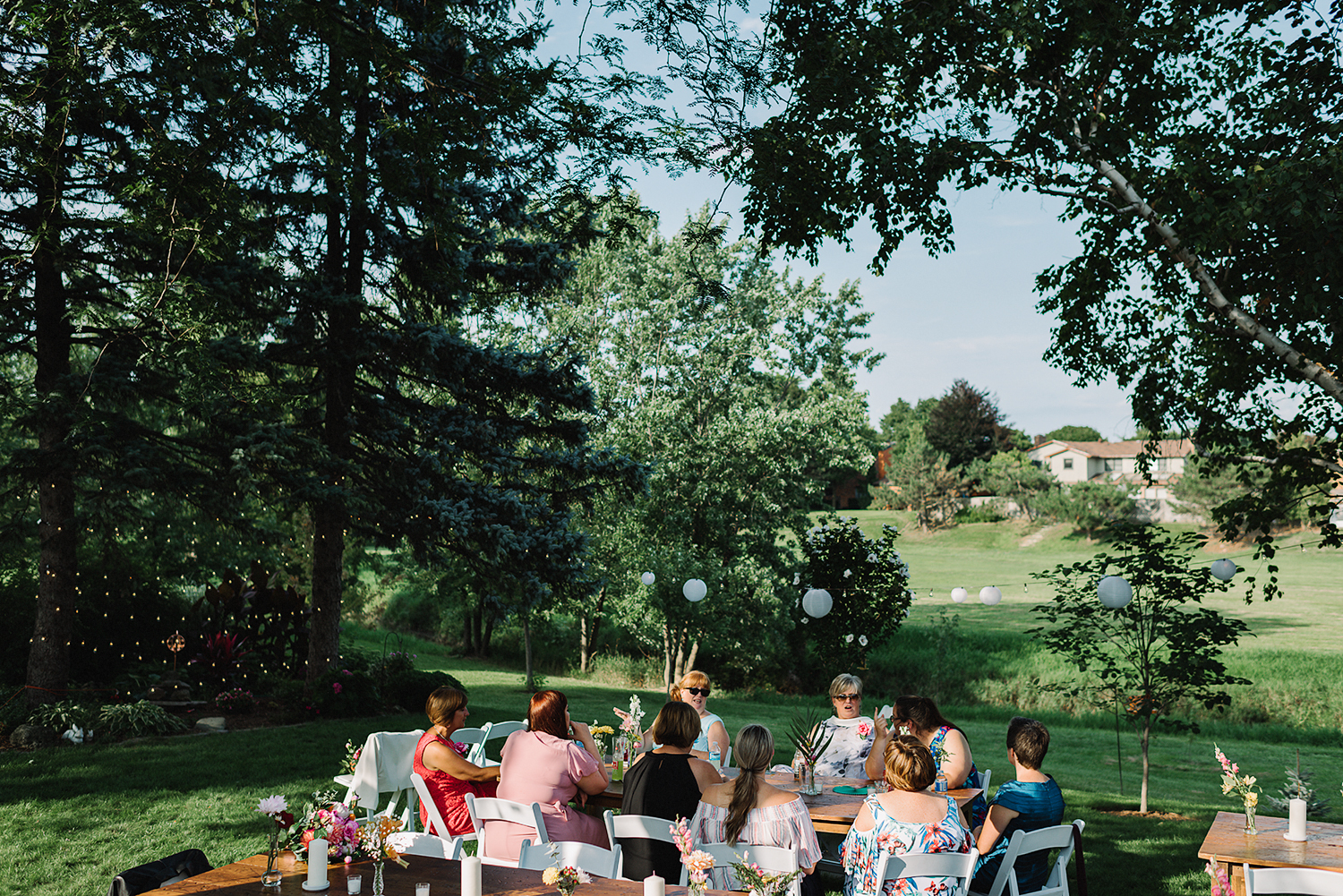 Backyard-family-intimate-cottage-wedding-chatum-kent-toronto-ontario-film-photographer-ryanne-hollies-photography-diy-string-lights-and-lanterns-reception-dinner-documentary-wooden-harvest-tables-diy-decor.jpg