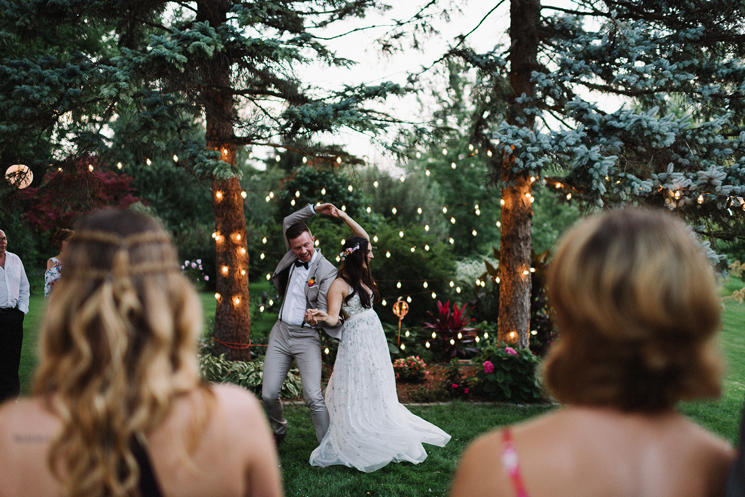 Backyard-toronto-film-photographer-ryanne-hollies-photography-diy-string-lights-and-lanterns-reception-first-dance-documentary-fun-candid-dancing.jpg