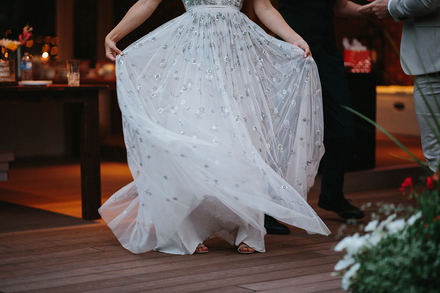 Backyard-toronto-film-photographer-ryanne-hollies-photography-diy-string-lights-and-lanterns-reception-first-dance-documentary-fun-candid-dancing-together-brides-dress.jpg