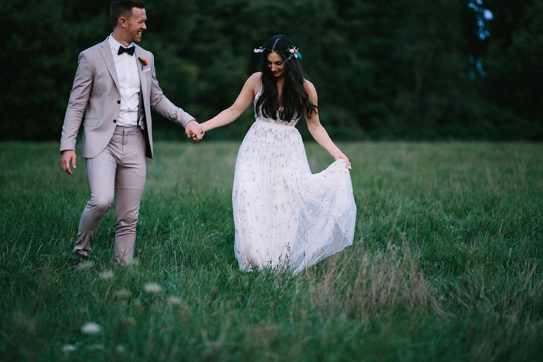 Backyard-toronto-film-photographer-ryanne-hollies-photography-analog-photography-torontos-best-wedding-photographers-night-portraits-bride-and-groom-candid-intimate-moody-dark-romantic-field-of-flowers-walking.jpg
