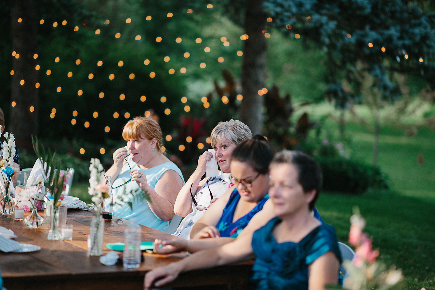 Backyard-toronto-film-photographer-ryanne-hollies-photography-diy-string-lights-and-lanterns-reception-dinner-documentary-wooden-harvest-tables-diy-decor-speeches-bride-and-grooms-dad-speech-cheering-emotional-everyone-crying-cute.jpg