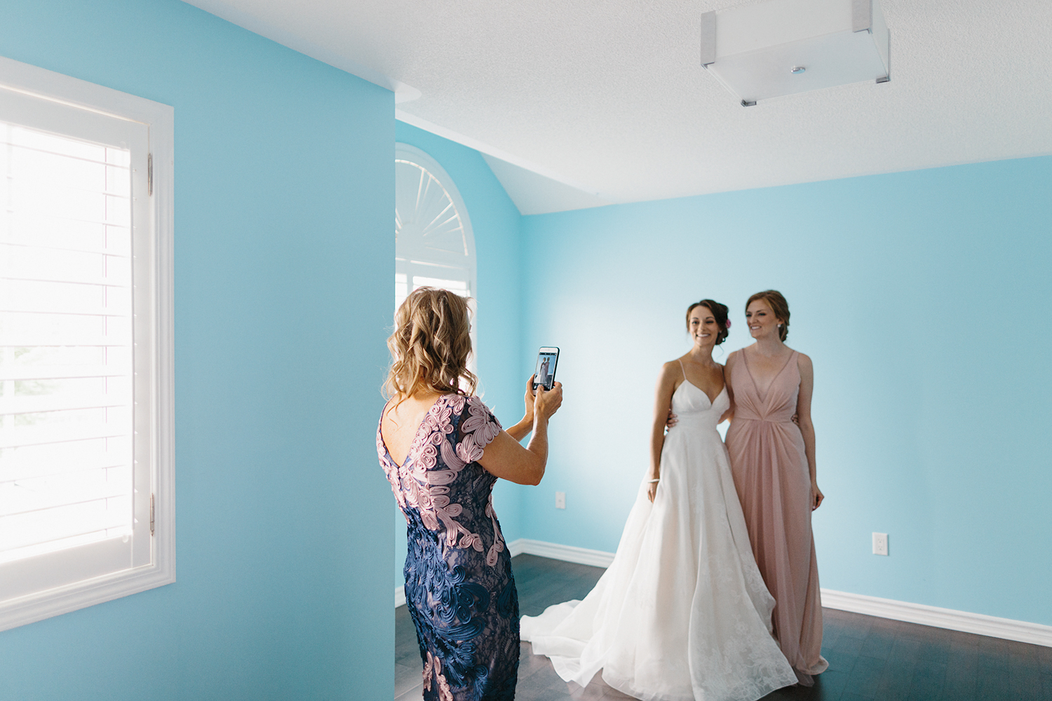 Best-Toronto-Wedding-Photographers-Photojournalistic-Wedding-Photography-in-Toronto-Ryanne-Hollies-Photography-candid-documentary-bradford-newmarket-bride-getting-ready-lea-ann-belter-bridal-mom-helping-with-dress-moments-taking-photos.jpg