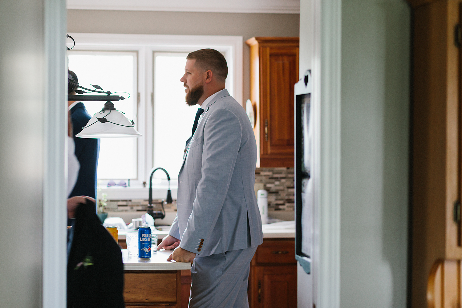 Alternative-Toronto-Wedding-Photographers-Photojournalistic-Wedding-Photography-in-Toronto-Ryanne-Hollies-Photography-candid-documentary-bradford-newmarket-groom-getting-ready-drinking-beer.jpg