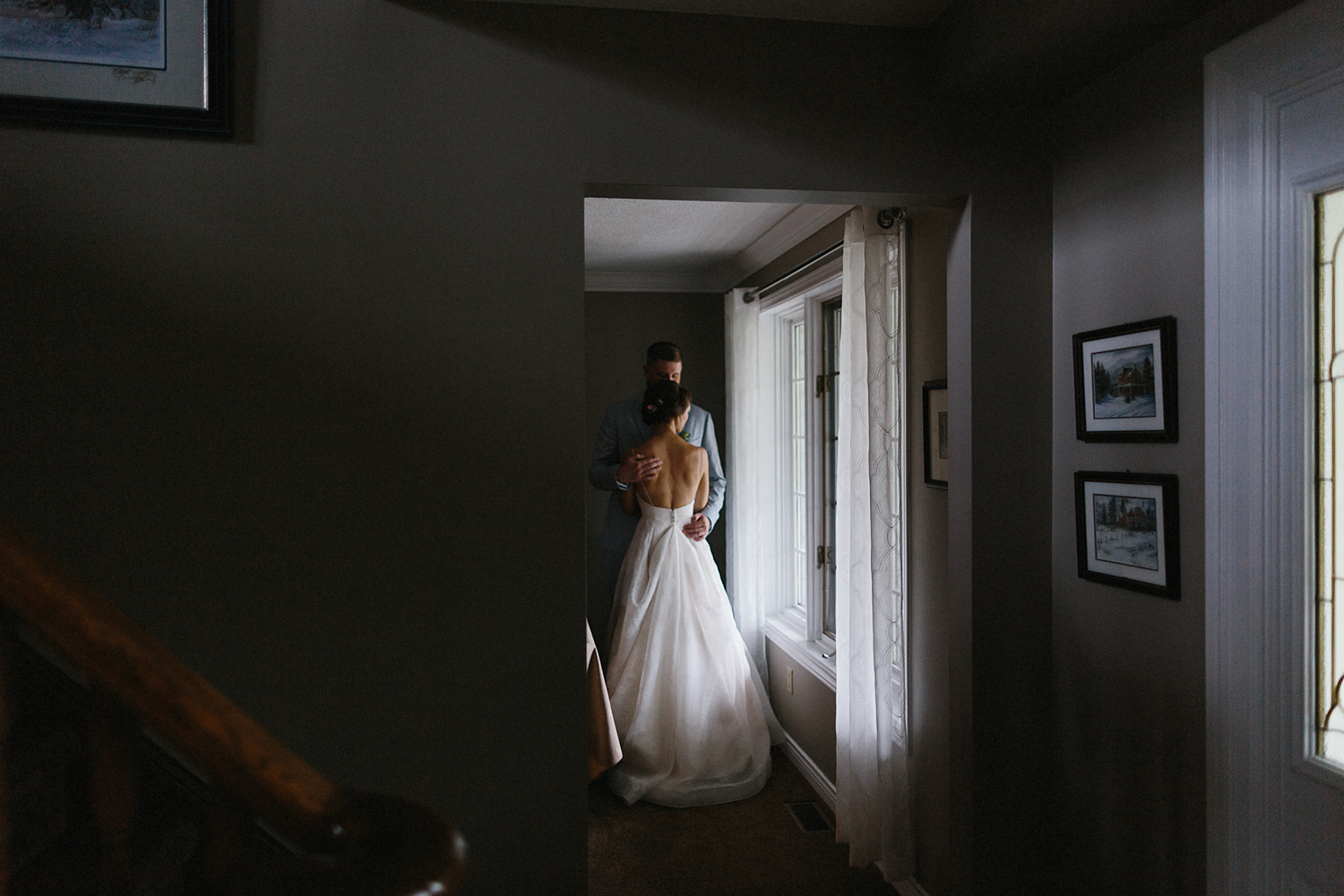 Best-Toronto-Wedding-Photographers-Photojournalistic-Wedding-Photography-in-Toronto-Ryanne-Hollies-Photography-candid-documentary-bradford-family-farm-rustic-venue-inspiration-moody-indoor-photos-by-window-bride-and-groom-at-home.jpg