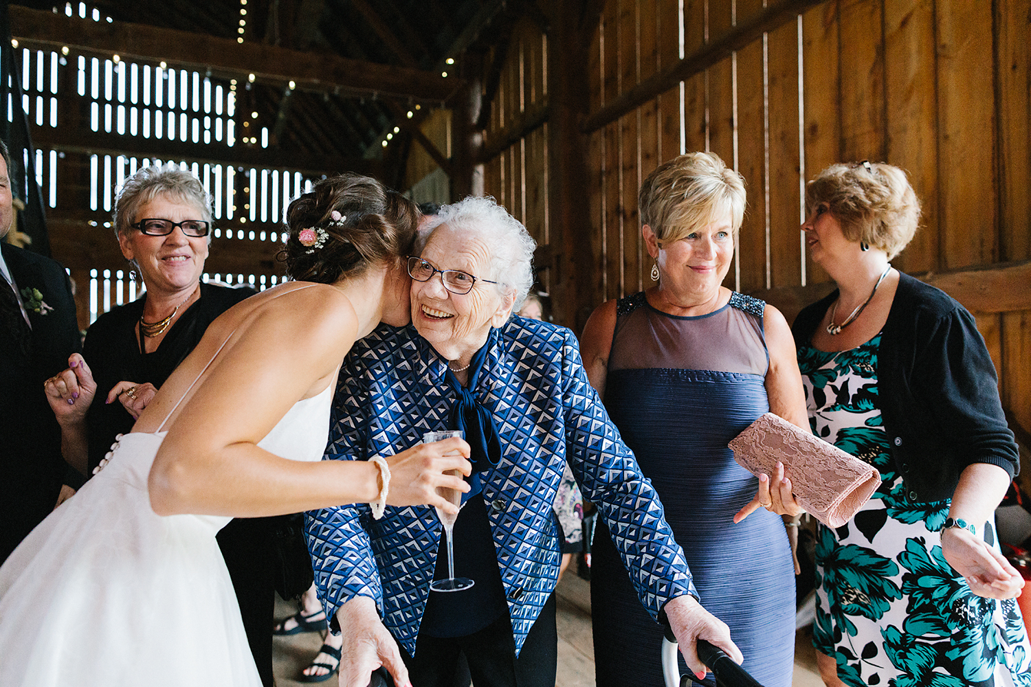 Alternative-Toronto-Wedding-Photographers-Photojournalistic-Wedding-Photography-in-Toronto-bradford-barn-farm-wedding-venue-rustic-inspiration-cocktail-hour-congratulations-grandma-cute.jpg
