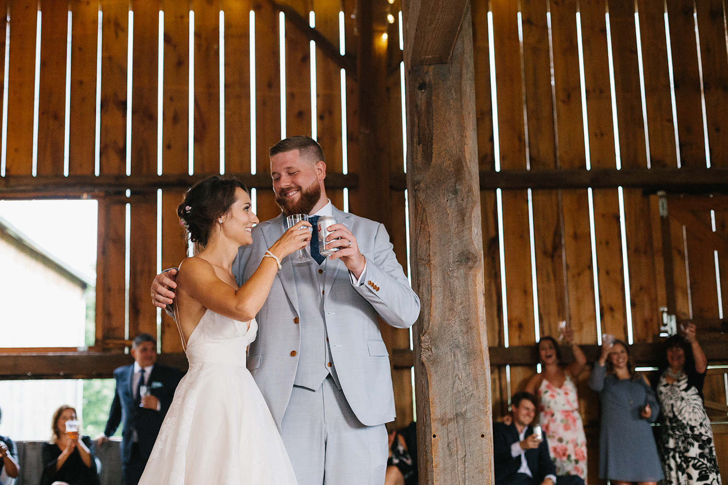 Candid-Toronto-Wedding-Photographers-Photojournalistic-Wedding-Photography-in-Toronto-Ryanne-Hollies-bradford-barn-farm-wedding-venue-inspiration-cinematic-reception-speeches-bride-and-groom-cheers-toast.jpg
