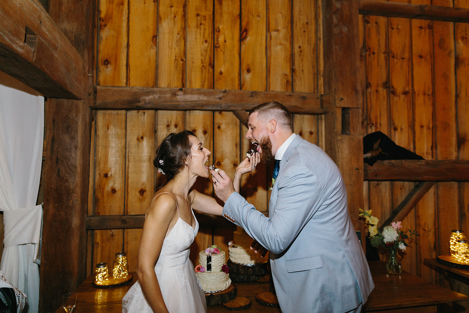 Candid-Toronto-Wedding-Photographers-Photojournalistic-Wedding-Photography-in-Toronto-Ryanne-Hollies-bradford-barn-best-dancing-photos-string-lights-party-time-bride-and-groom-cake-cutting-diy-cute-moments.jpg