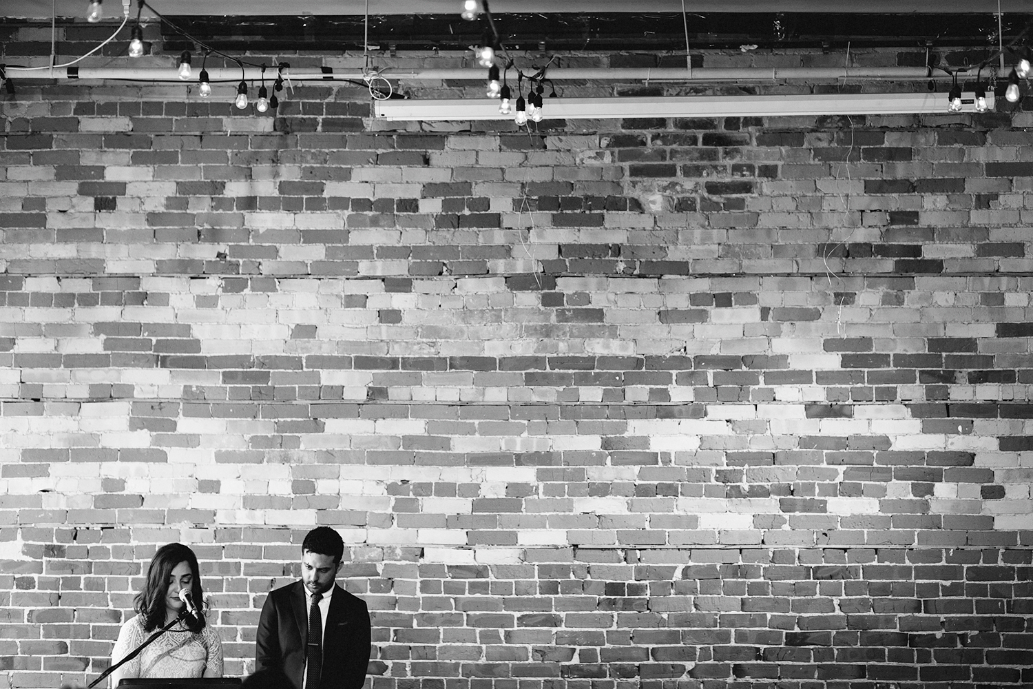 Best-Analog-Film-Wedding-Photographers-Toronto-Downtown-Urban-Gladstone-Hotel-Venue-Inspiration-Top-Venues-in-Toronto-boutique-hotel-candid-documentary-brunch-ceremony-bride-and-groom-moments-together-bride-vows-emotional-cinematic-bw.jpg