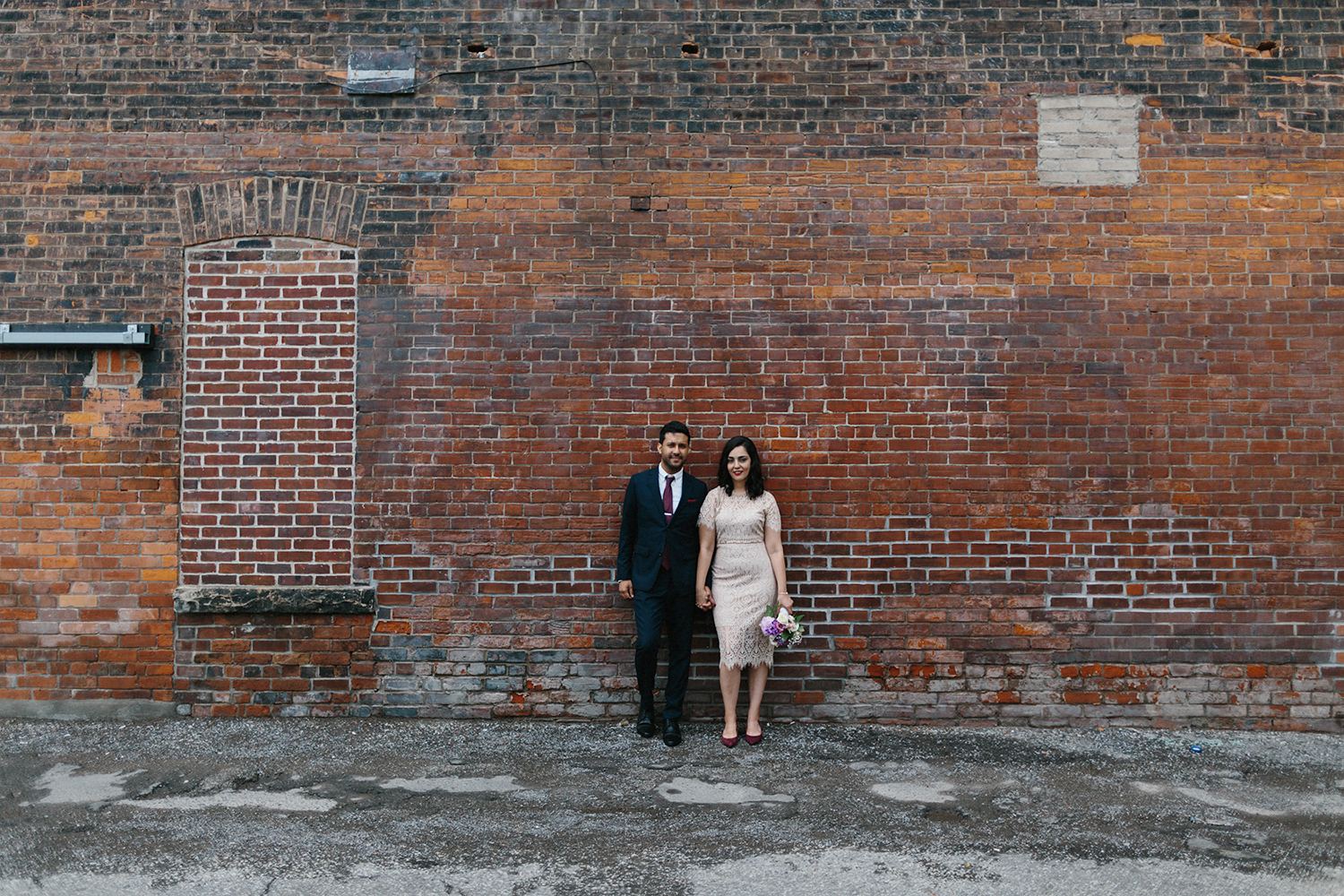 Best-Wedding-Photographers-in-Toronto-Downtown-Urban-Gladstone-Hotel-Venue-Inspiration-Top-Venues-in-Toronto-boutique-hotel-candid-documentary-brunch-wedding-couples-portraits-old-toronto-brick-art-badass.jpg