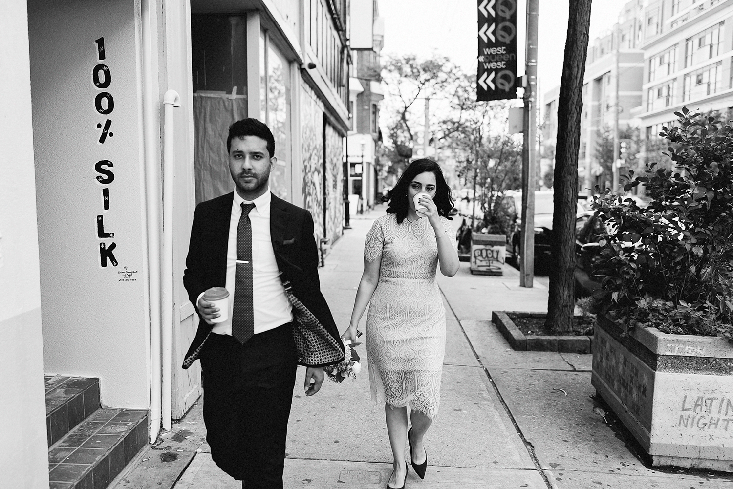 Best-Toronto-Wedding-Photographers-Afforadable-Candid-Photojournalistic-Photography-Toronto-Gladstone-Hotel-Wedding-Venue-Downtown-Urban-Brunch-Wedding-Inspiration-persian-Ceremony-Bride-and-Groom-Portraits-Walking-Along-Queen-Street-West.jpg