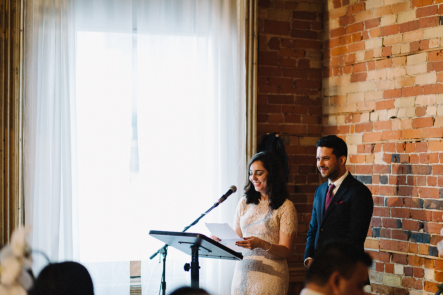 Best-photojournalistic-wedding-photographers-in-toronto-documentary-style-wedding-photography-ryanne-hollies-intimate-portraits-of-bride-and-groom-inside-gladstone-speeches-reactions.jpg