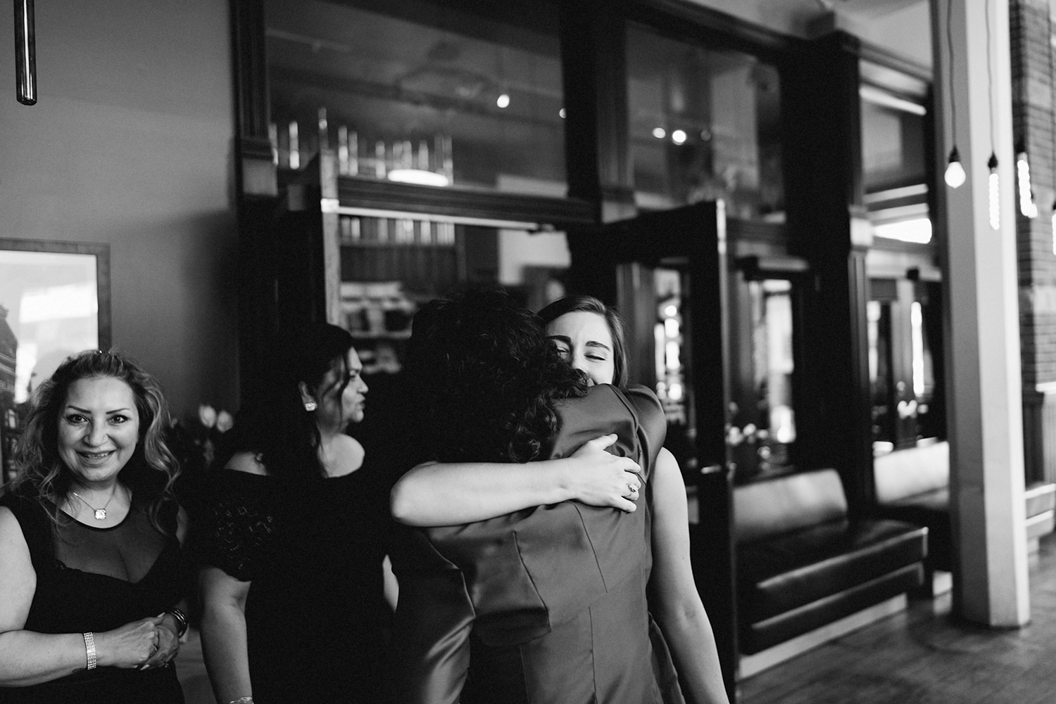 Best-Toronto-Wedding-Photographers-Afforadable-Candid-Photojournalistic-Photography-Toronto-Gladstone-Hotel-Wedding-Venue-Downtown-Urban-Brunch-Wedding-Inspiration-persian-ceremony-gettings-hugging.jpg