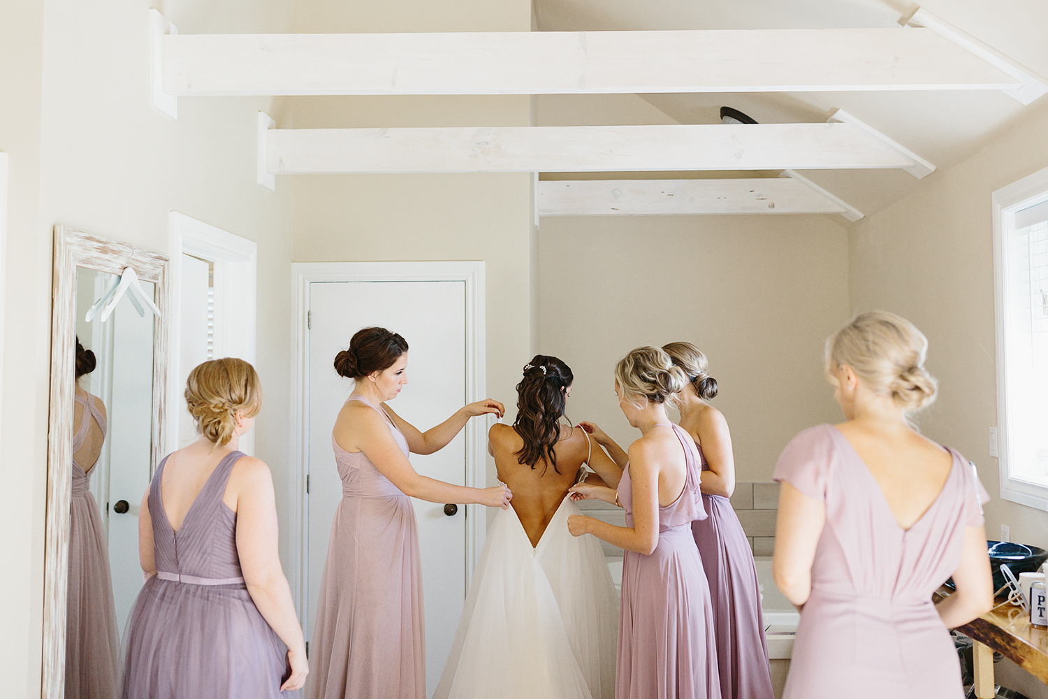 muskoka-wedding-photographer-toronto-wedding-photography-hidden-valley-resort-documentary-photojournalistic-fine-art-wedding-photography-getting-ready-bride-giving-her-mom-a-gift.jpg
