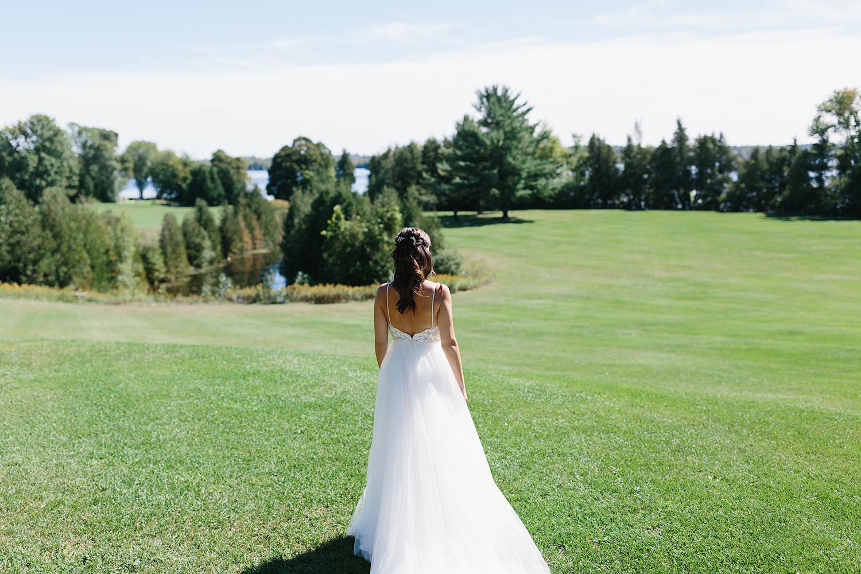 Bride-walking-up-togroom-from-far-away-At-Egaridge-Resort-Venue-Muskoka-Ontario.jpg