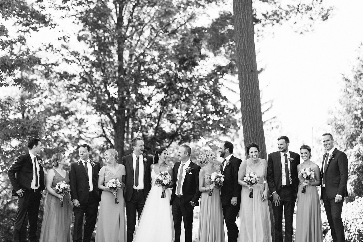 Bridal-Party-all-together-At-Egaridge-Resort-Venue-Muskoka-Ontario-Wedding-Photography-by-Ryanne-Hollies-Photography-Toronto-Documentary-Wedding-Photographer.jpg