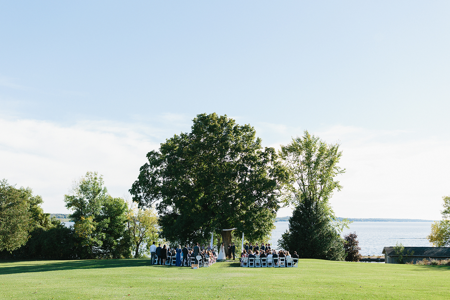 ceremony-bride-and-groom-vows-At-Egaridge-Resort-Venue-Muskoka-Ontario-Wedding-Photography-by-Ryanne-Hollies-Photography-Toronto-Documentary-Wedding-Photographer.jpg