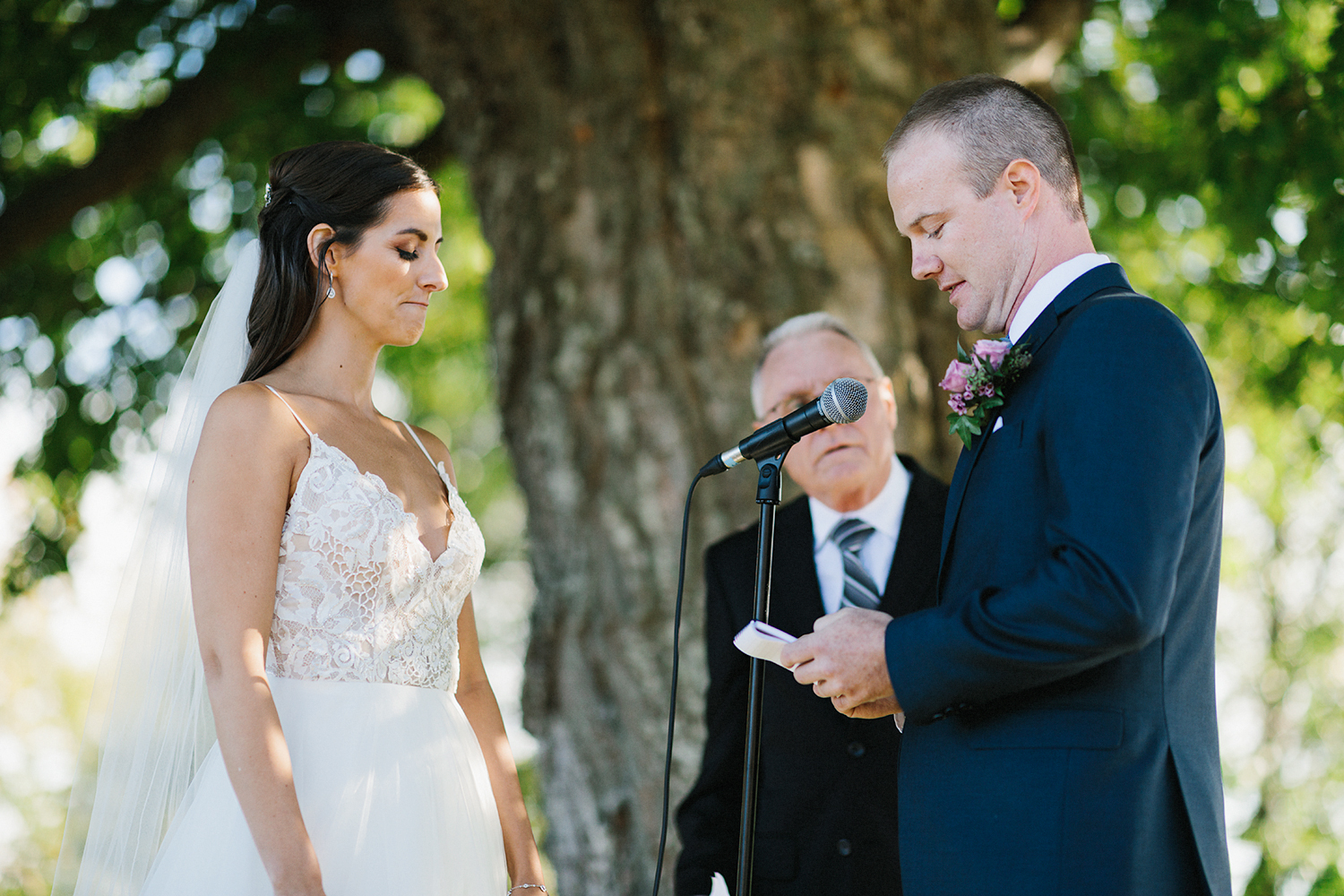 23-toronto-wedding-photographers-hidden-valley-resort-ryanne-hollies-photography-documentary-photojournalistic-fine-art-wedding-photography-lakeside-ceremony-cottage-country-bride-and-groom-vows-groomsman-crying.jpg