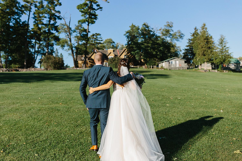 ceremony-bride-and-groom-just-married-recessional-walking-away-At-Eganridge-Resort-Venue-Muskoka-Ontario-Wedding-Photography-by-Ryanne-Hollies-Photography-Toronto-Documentary-Wedding-Photographer.jpg