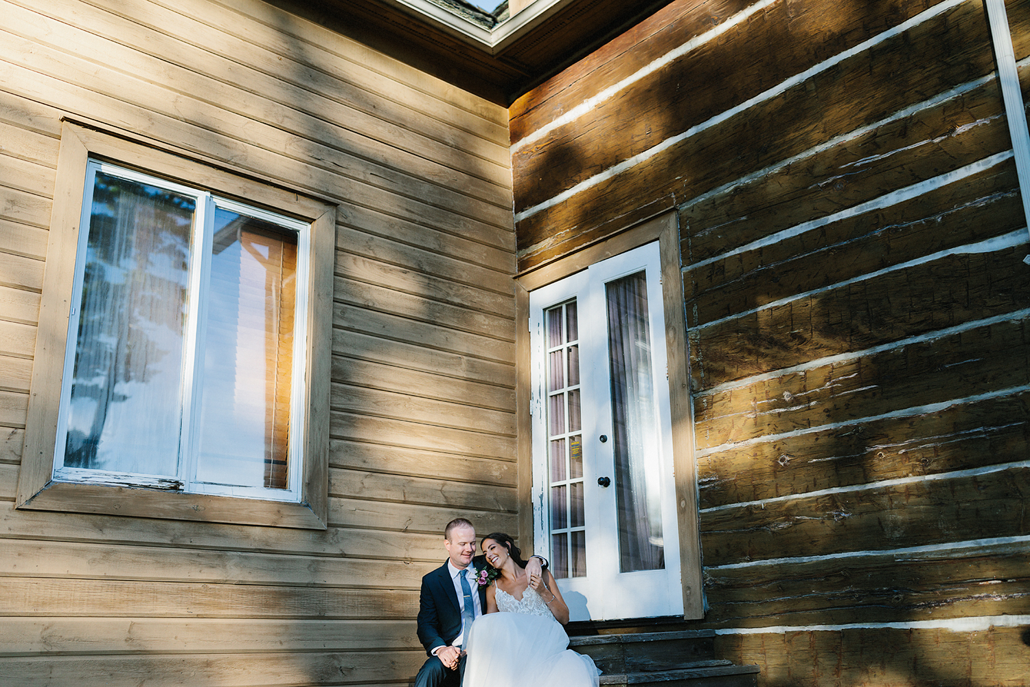 golden-hour-portraits-with-bride-and-groom-in-cottage-At-Eganridge-Resort-Venue-Muskoka-Ontario-Wedding-Photography-by-Ryanne-Hollies-Photography-Toronto-Documentary-Wedding-Photographer.jpg