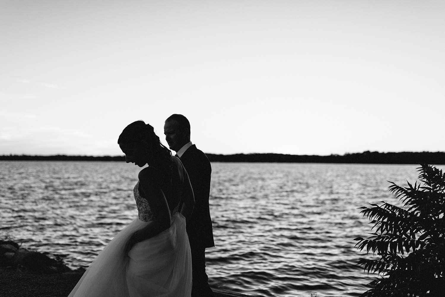 sunset-golden-hour-couples-portraits-candid-moment-walking-At-Eganridge-Resort-Venue-Muskoka-Ontario-Wedding-Photography-by-Ryanne-Hollies-Photography-Toronto-Documentary-Wedding-Photographer.jpg