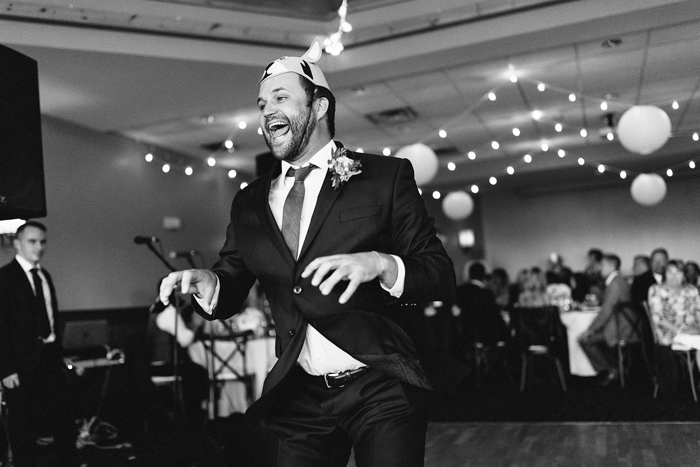 reception-groomsmen-entrance-wearing-funny-hats-dancing-At-Eganridge-Resort-Venue-Muskoka-Ontario-Wedding-Photography-by-Ryanne-Hollies-Photography-Toronto-Documentary-Wedding-Photographer.jpg