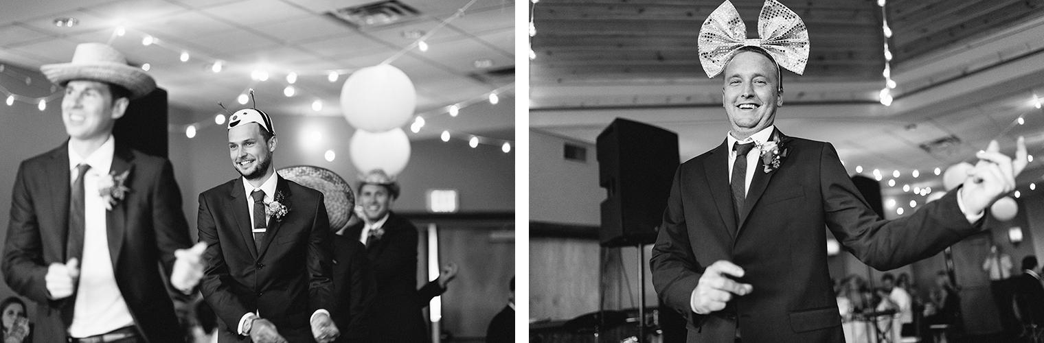 14-reception-groomsmen-entering-wearing-goofy-hats-dancing-At-Eganridge-Resort-Venue-Muskoka-Ontario-Wedding-Photography-by-Ryanne-Hollies-Photography-Toronto-Documentary-Wedding-Photographer.jpg