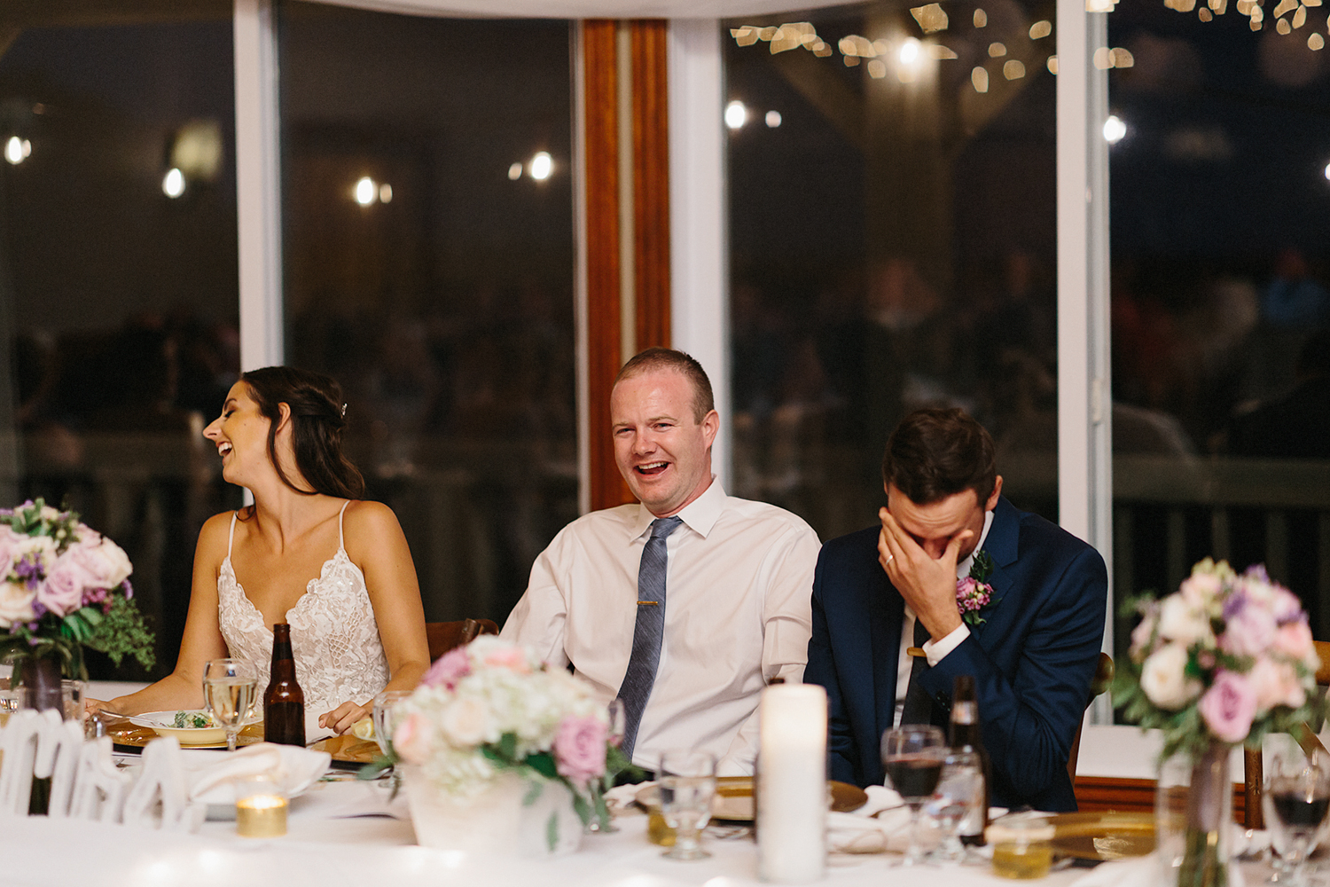 groom-and-groomsmen-laughing-at-speech-during-reception-At-Eganridge-Resort-Venue-Muskoka-Ontario-Wedding-Photography-by-Ryanne-Hollies-Photography-Toronto-Documentary-Wedding-Photographer.jpg
