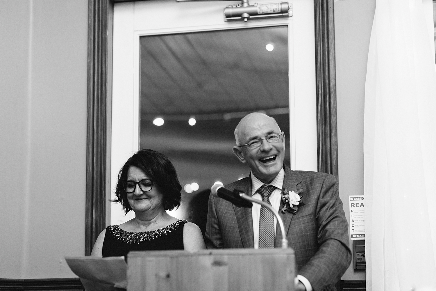 grooms-parents--speech-funny-jokes-during-reception-At-Eganridge-Resort-Venue-Muskoka-Ontario-Wedding-Photography-by-Ryanne-Hollies-Photography-Toronto-Documentary-Wedding-Photographer.jpg