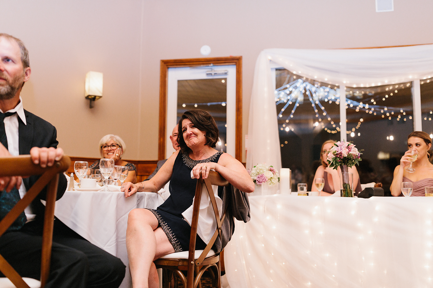 bride-and-groom-speech-mom-crying-during-reception-At-Eganridge-Resort-Venue-Muskoka-Ontario-Wedding-Photography-by-Ryanne-Hollies-Photography-Toronto-Documentary-Wedding-Photographer.jpg