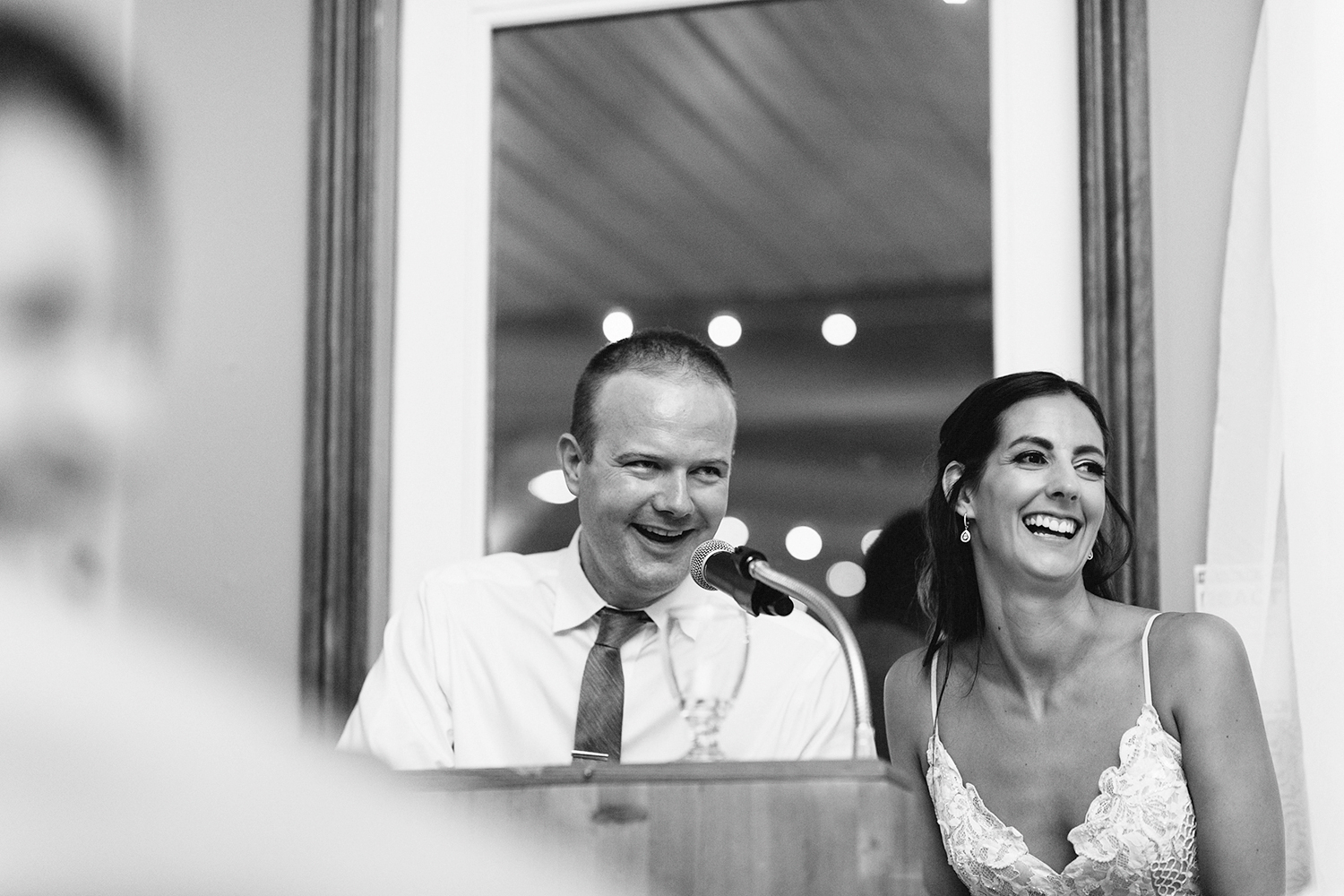 bride-and-groom-speech-during-reception-At-Eganridge-Resort-Venue-Muskoka-Ontario-Wedding-Photography-by-Ryanne-Hollies-Photography-Toronto-Documentary-Wedding-Photographer.jpg