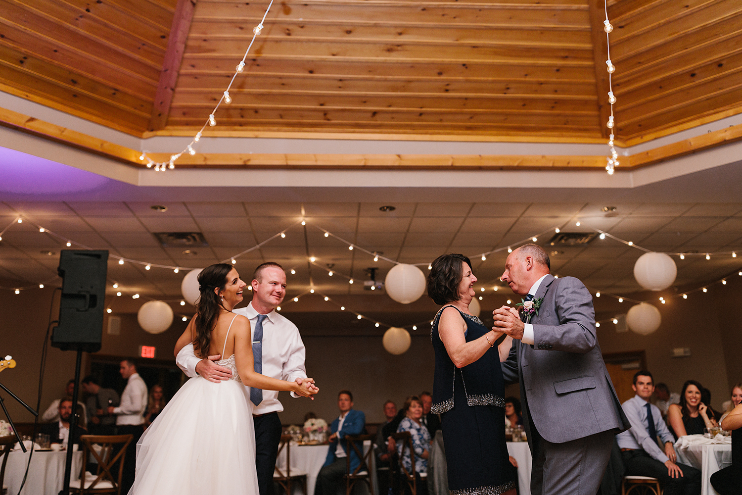 candid-mother-son-dance--father-daughter-together-reception-At-Eganridge-Resort-Venue-Muskoka-Ontario-Wedding-Photography-by-Ryanne-Hollies-Photography-Toronto-Documentary-Wedding-Photographer.jpg