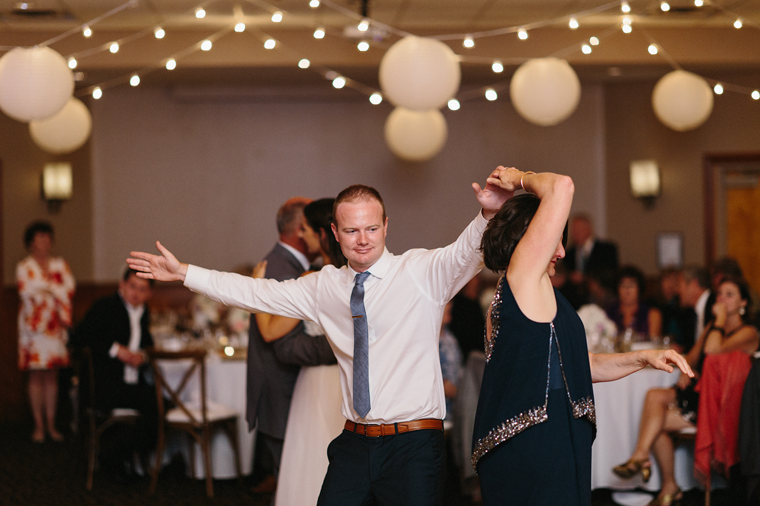 mother-son-dance-candid-cute-funny-reception-At-Eganridge-Resort-Venue-Muskoka-Ontario-Wedding-Photography-by-Ryanne-Hollies-Photography-Toronto-Documentary-Wedding-Photographer.jpg