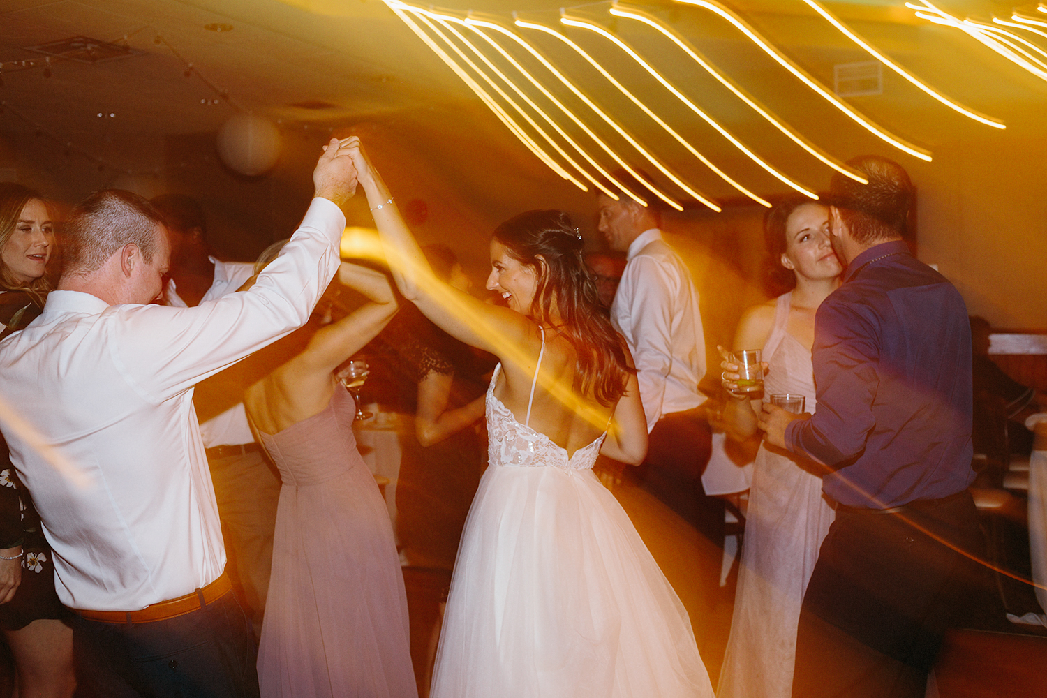 candid-bride-and-groom-dancing-at-reception-At-Eganridge-Resort-Venue-Muskoka-Ontario-Wedding-Photography-by-Ryanne-Hollies-Photography-Toronto-Documentary-Wedding-Photographer.jpg