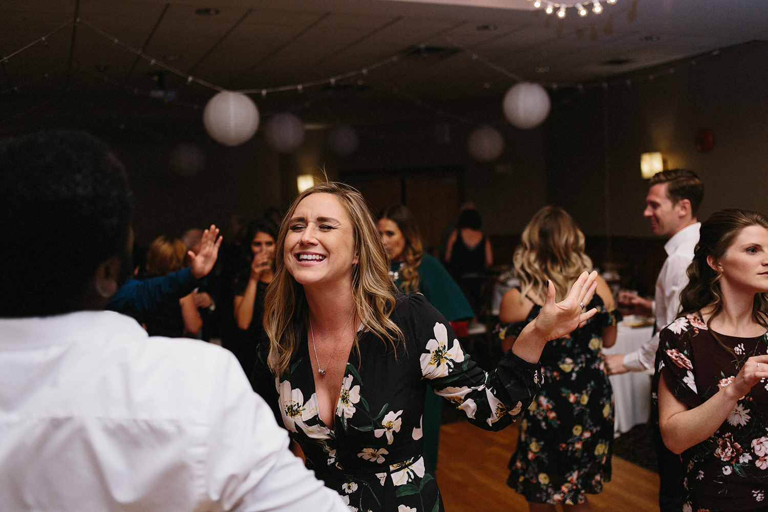 candid-guests-dancing-reception-At-Eganridge-Resort-Venue-Muskoka-Ontario-Wedding-Photography-by-Ryanne-Hollies-Photography-Toronto-Documentary-Wedding-Photographer.jpg