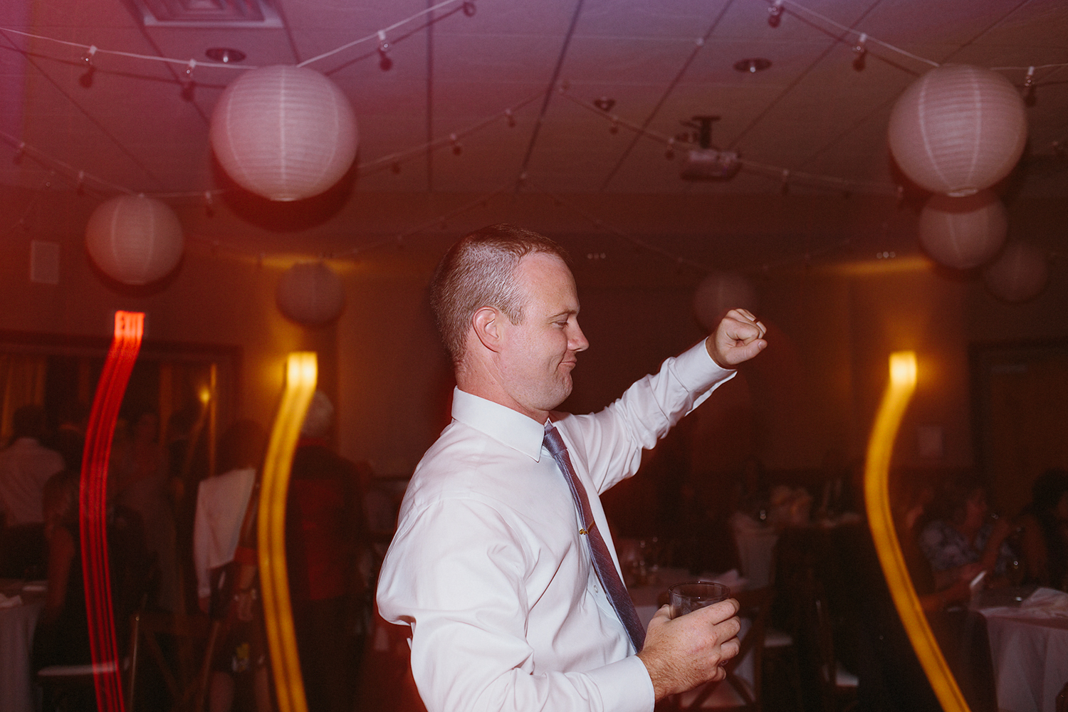 groom-dancing-partying-live-band-at-reception-At-Eganridge-Resort-Venue-Muskoka-Ontario-Wedding-Photography-by-Ryanne-Hollies-Photography-Toronto-Documentary-Wedding-Photographer.jpg