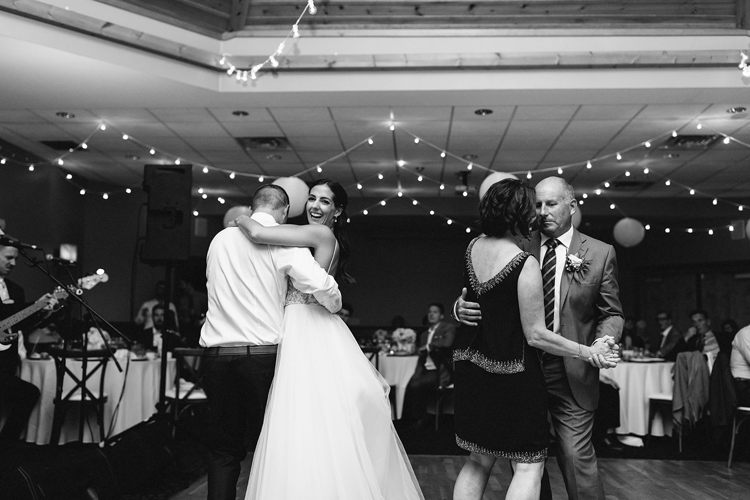 mother-son-dance--father-daughter-together-reception-At-Eganridge-Resort-Venue-Muskoka-Ontario-Wedding-Photography-by-Ryanne-Hollies-Photography-Toronto-Documentary-Wedding-Photographer.jpg