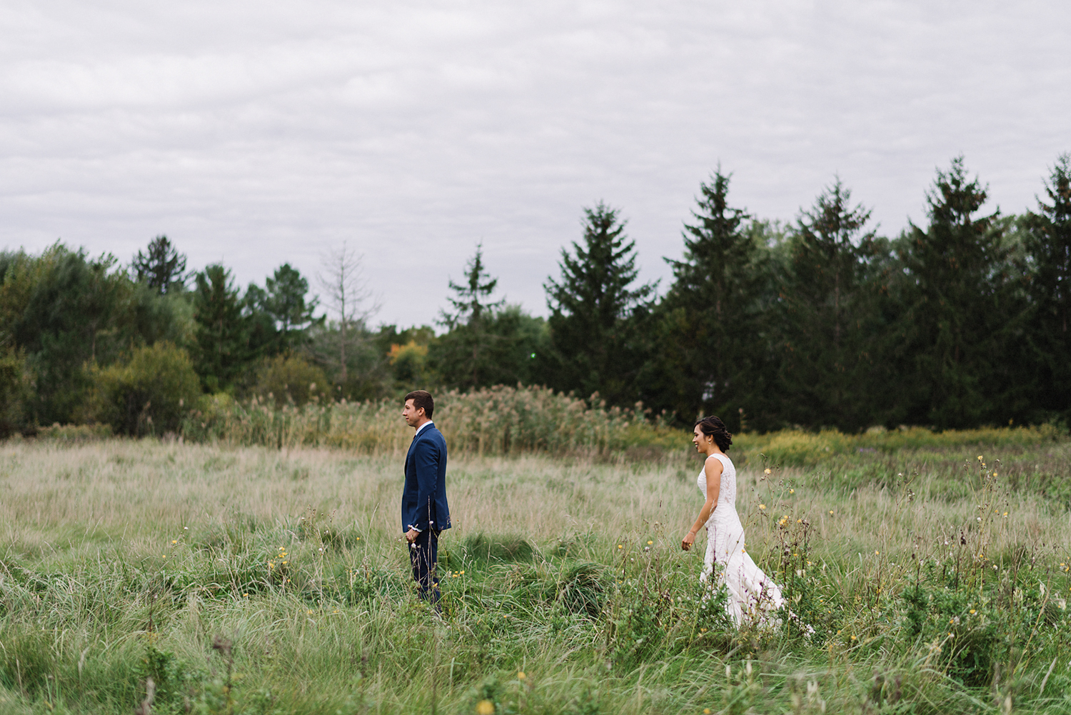 bellamere-winery-cottage-first-look-bride-walking-up-cinetmatic-best-torontos-wedding-photographers-candid-documentary-style-photography-london-ontario-winery-wedding-inspiration.jpg