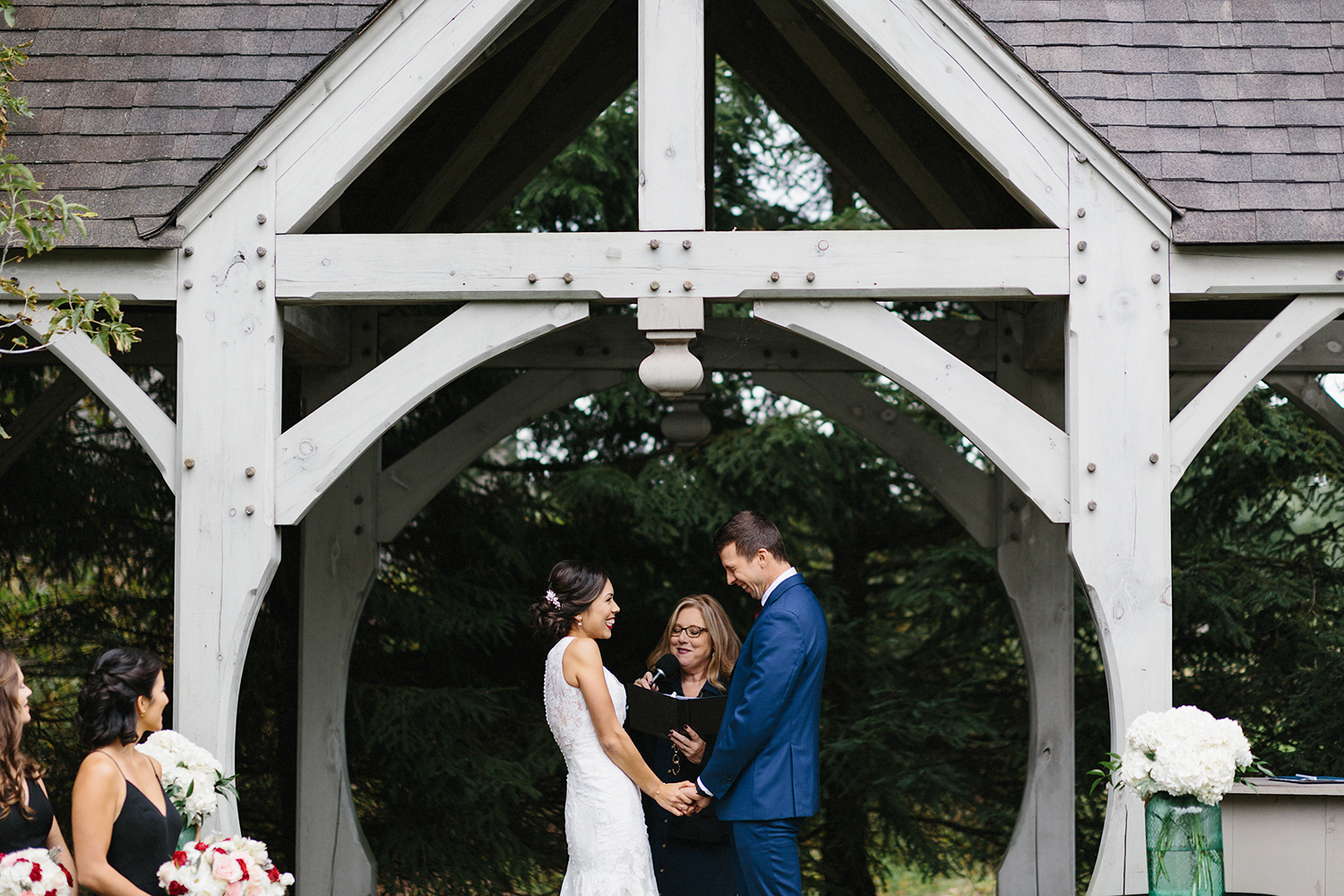 Backyard-family-intimate-cottage-wedding-chatum-kent-toronto-ontario-film-photographer-ryanne-hollies-photography-diy-string-lights-and-lanterns-reception-dinner-documentary-wooden-harvest-tables-diy-decor-pink-flowers.jpg