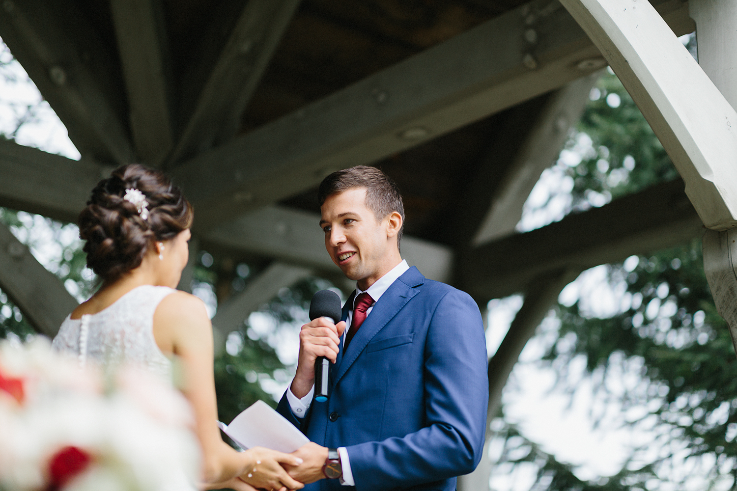 bellamere-winery-ceremony-rustic-groom-saying-vows-guests-laughing-smiling-cinematic-toronto's-best-wedding-photographers-candid-documentary-style-photography-london-ontario-winery-wedding-inspiration.jpg