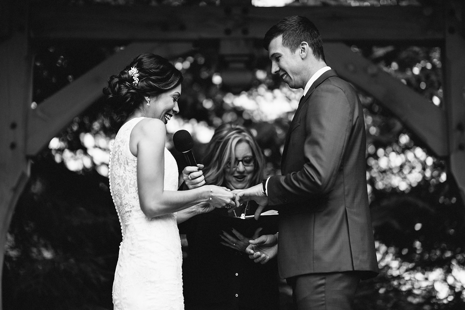 ceremony-rustic-bride-and-groom-exchanging-rings-cinematic-toronto's-best-wedding-photographers-candid-documentary-style-photography-london-ontario-winery-wedding-inspiration.jpg