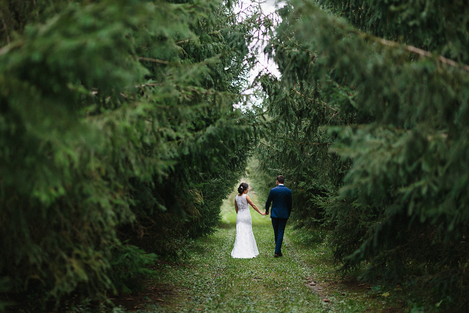 bride-and-groom-couples-portraits-in-forest-wilderness-outdoors-romantic-moody-walking-real-moments-photos-toronto's-best-wedding-photographers-candid-documentary-style-photography-london-ontario-winery-wedding-inspiration.jpg