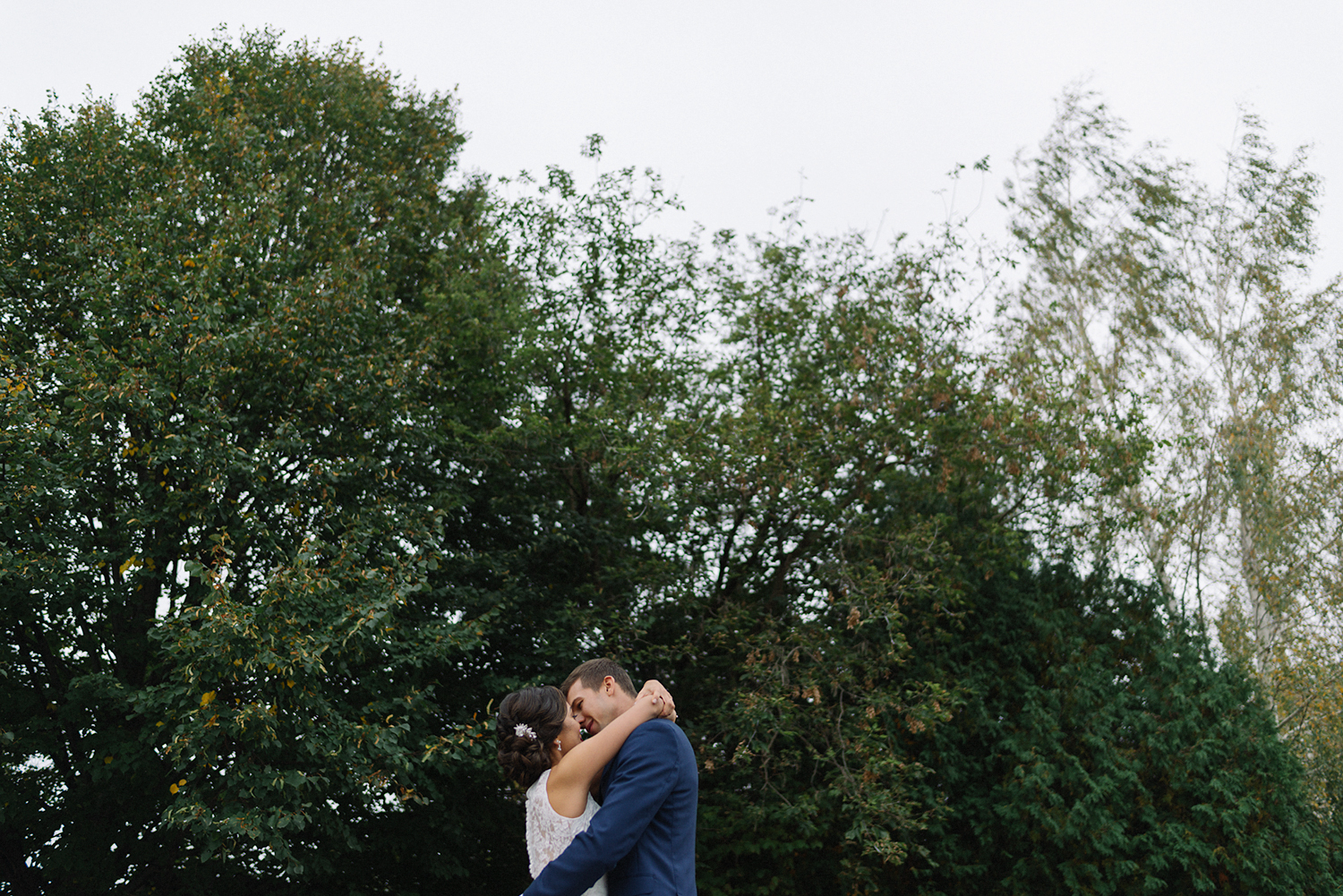bride-and-groom-portraits-in-trees-epic-cinematic-toronto's-best-analog-documentary-wedding-photographers-candid-photography-london-ontario-wedding-inspiration.jpg