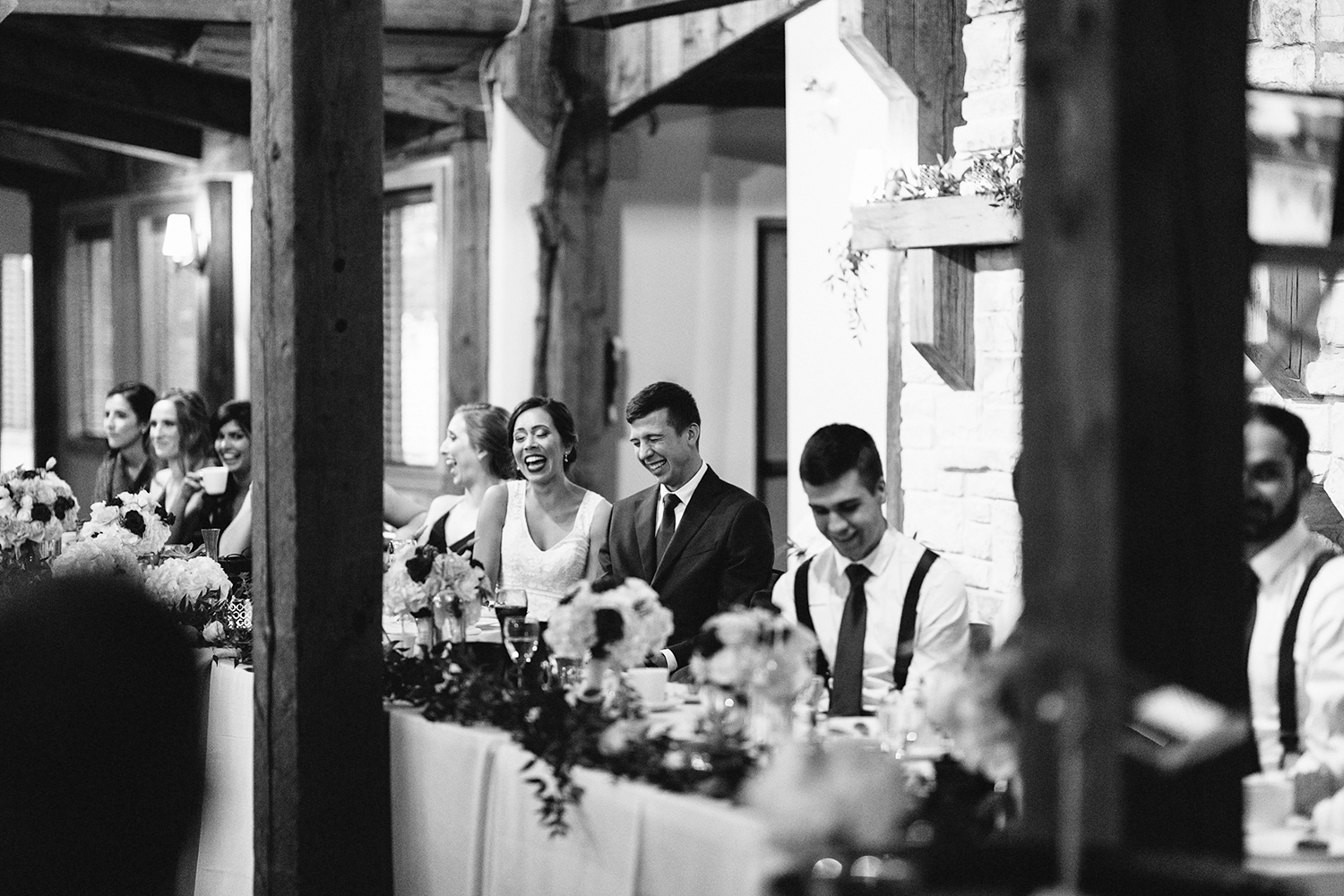 reception-diy-bride-and-groom-speeches-bride-and-groom-laughing-toronto's-best-analog-documentary-wedding-photographers-candid-photography-london-ontario-wedding-inspiration.jpg