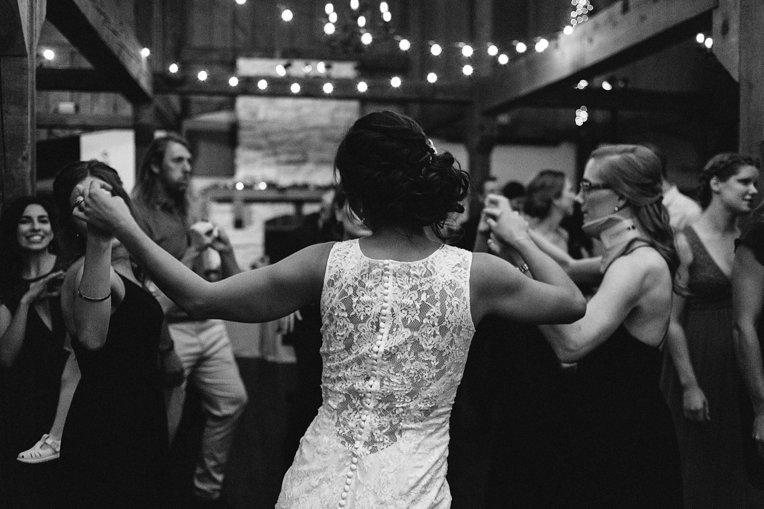 party-guests-dancing-having-fun-partying-hugging-candid-moments-toronto's-best-analog-documentary-wedding-photographers-candid-photography-london-ontario-wedding-inspiration.jpg