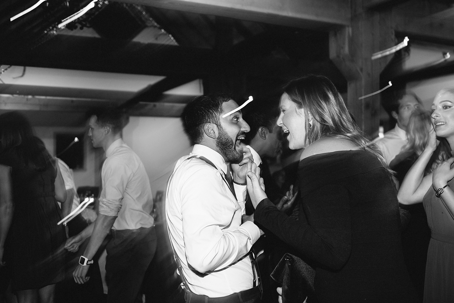 guests-dancing-partying-candid-moments-toronto's-best-analog-documentary-wedding-photographers-candid-photography-london-ontario-wedding-inspiration.jpg