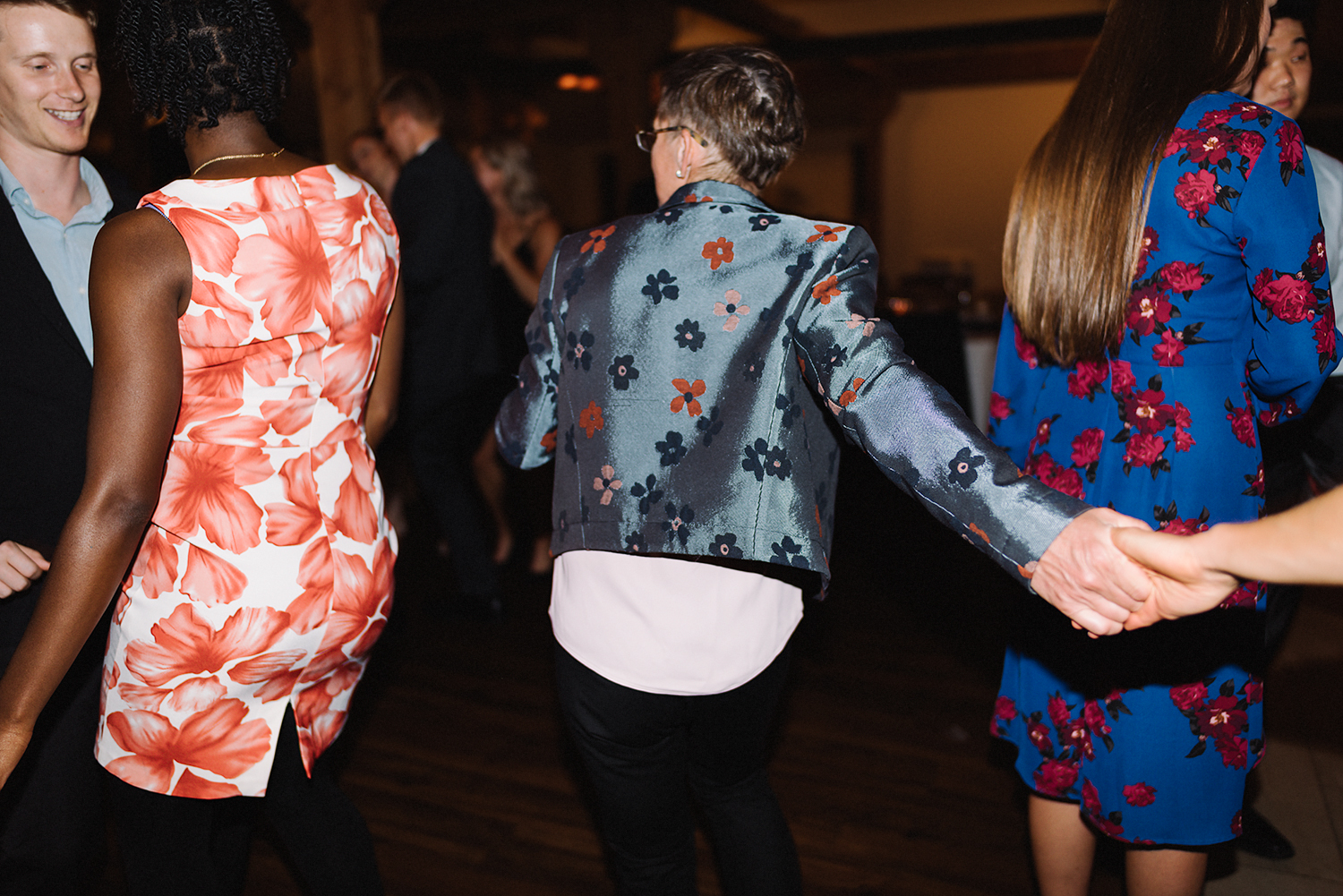 guests-dancing-bride-and-mom-dancing-together-partying-candid-moments-toronto's-best-analog-documentary-wedding-photographers-candid-photography-london-ontario-wedding-inspiration.jpg