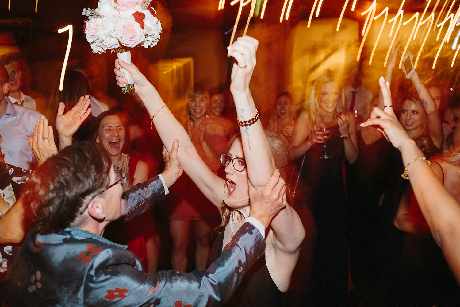 bride-bouquet-toss-candid-moments-toronto's-best-analog-documentary-wedding-photographers-candid-photography-london-ontario-wedding-inspiration.jpg